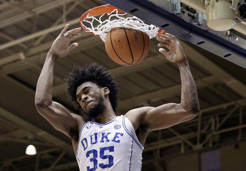 Duke's Marvin Bagley III (35) dunks during the first half of an NCAA college basketball game against South Dakota in Durham, N.C., Saturday, Dec. 2, 2017. (AP Photo/Gerry Broome)