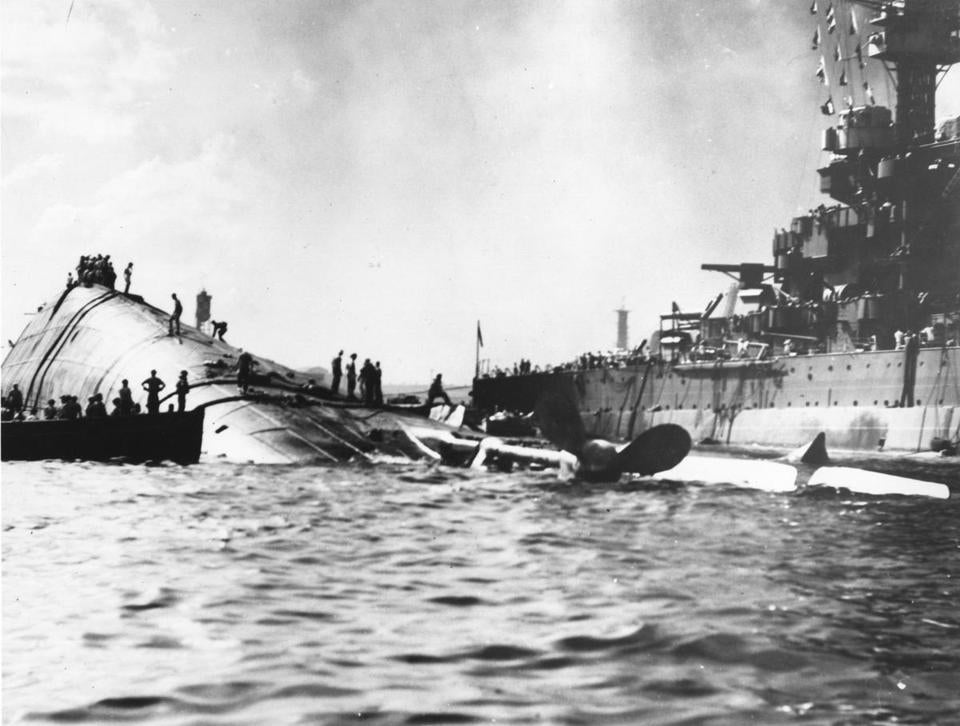 Nacy personnel inspected the capsized USS Oklahoma after the Japanese attack on Pearl Harbor in Hawaii in 1941.