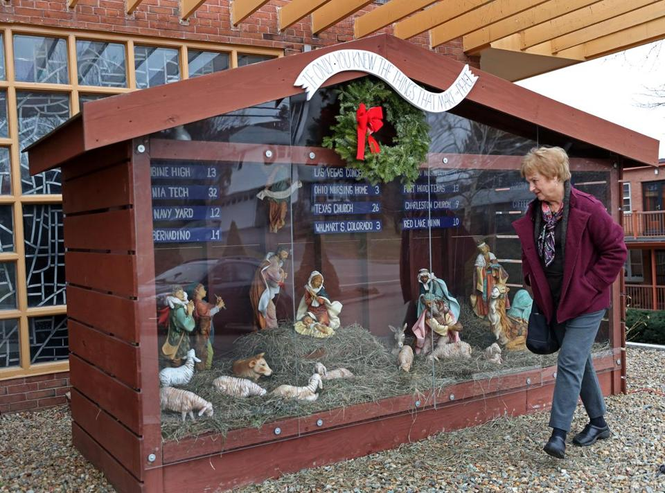 Pat Ferrone helped put together the Nativity scene outside the St. Susanna Church in Dedham.