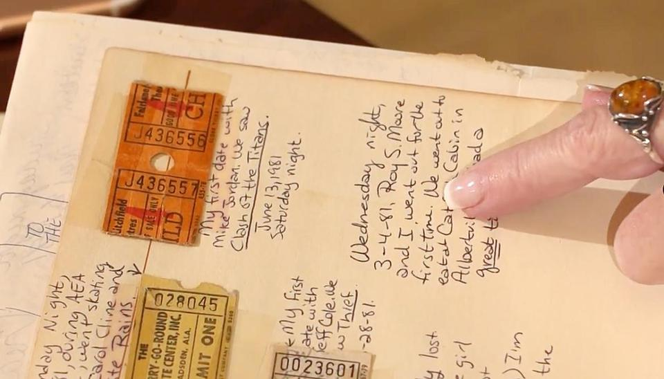 Debbie Wesson Gibson points to an entry in her high school scrapbook, where she noted what she says was her first date with Roy Moore.