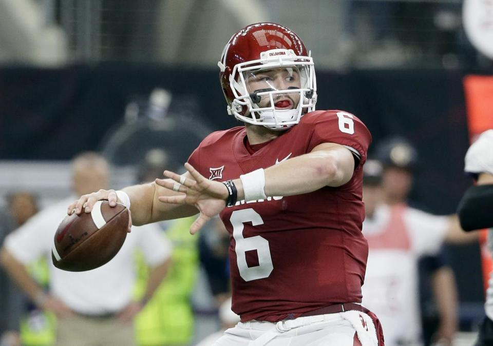 FILE - In this Dec. 2, 2017, file photo, Oklahoma quarterback Baker Mayfield (6) throws a pass in the first half of the Big 12 Conference championship NCAA college football game against TCU in Arlington, Texas. Mayfield, reigning Heisman winner Lamar Jackson of Louisville and Stanford running back Bryce Love were chosen as finalists for the Heisman Trophy on Monday, Dec. 4, 2017. (AP Photo/Tony Gutierrez, File)
