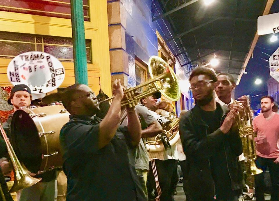 A brass band gets the crowd moving on Frenchmen Street in New Orleans.