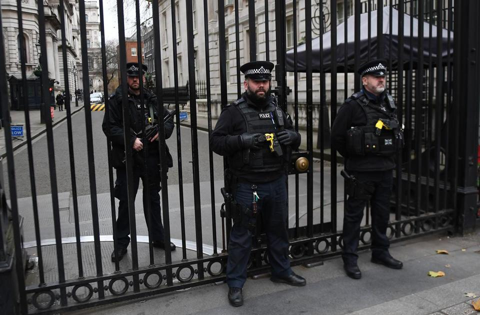 Mandatory Credit: Photo by ANDY RAIN/EPA-EFE/REX/Shutterstock (9262609k) British armed police on guard outside the gates of 10 Downing Street in central London, Britain, 06 December 2017. Media reports on 06 December 2017 state that two men arrested last week have been charged with terrorism offences related to allegedly planning to bomb Downing Street security gates and then attack Prime Minister Theresa May with a knife. Prime Minister Theresa May security folowing terror plot, London, United Kingdom - 06 Dec 2017