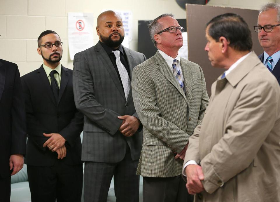 Ex-guards on trial (from left) John Raposo, Derek Howard, and George Billadeau, with Judge Jeffrey Locke (right, looking back at them), on Wednesday visited the facility where Joshua Messier died.