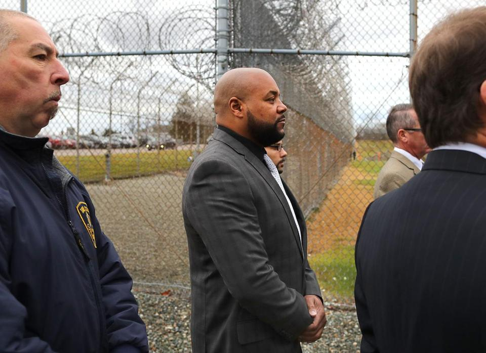 One of the guards on trial, Derek Howard, walked to the entrance of the facility.