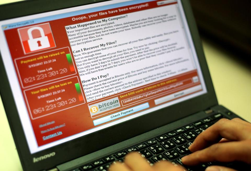 A ransomware cyberattack captured on a laptop.