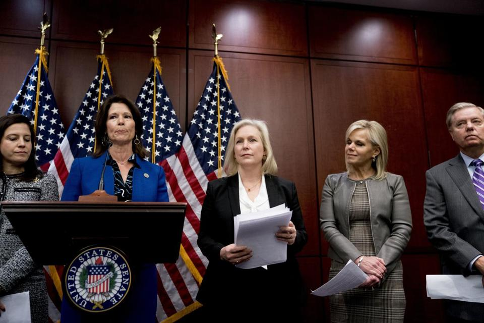 From left, Rep. Elise Stefanik, R-N.Y., Rep. Cheri Bustos, D-Ill., Sen. Kirsten Gillibrand, D-N.Y., Gretchen Carlson, and Sen. Lindsey Graham, R-S.C., held a news conference to introduce legislation to curb sexual harassment in the workplace, on Capitol Hill on Wednesday.
