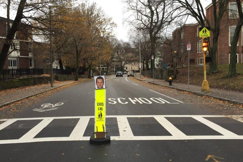A teacher in Roxbury put cut outs of Tom Brady's head on crosswalk signs outside of the Ellis Elementary School so drivers would slow down.