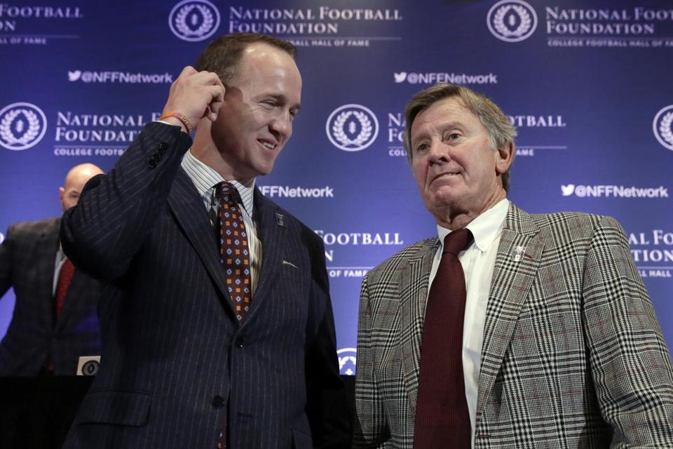 Rivals in the Southeastern Conference, Peyton Manning (left) and Steve Spurrier (right) were inducted into the College Football Hall of Fame Tuesday night.