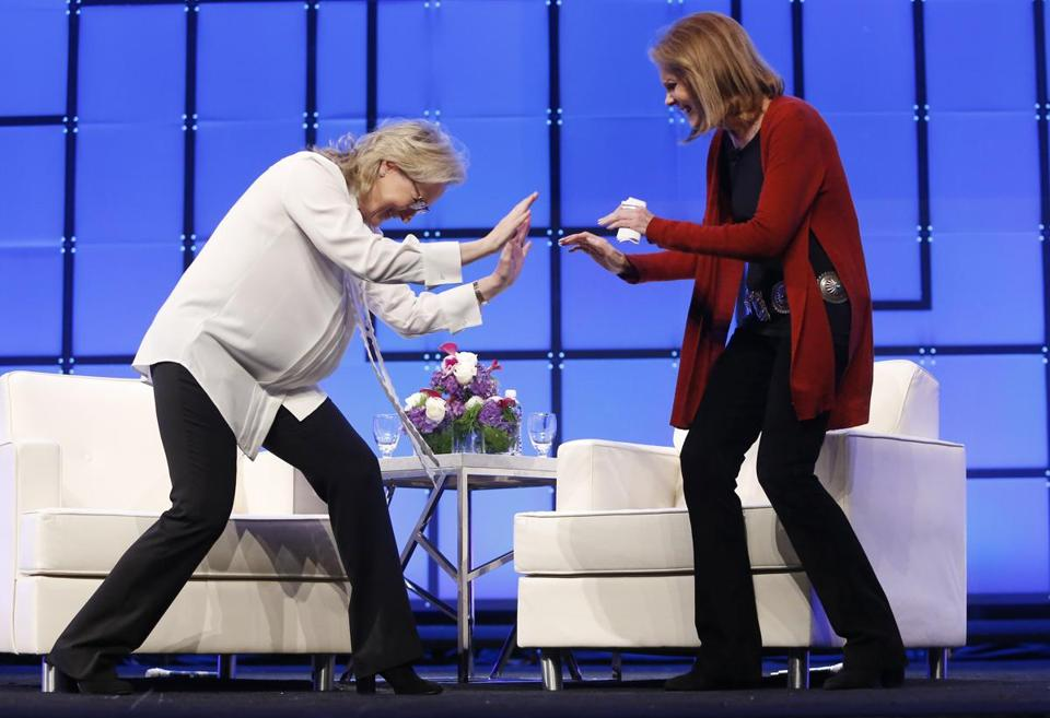 Meryl Streep (left) jokingly bowed down to Gloria Steinem as they arrived to speak at the Massachusetts Conference for Women.