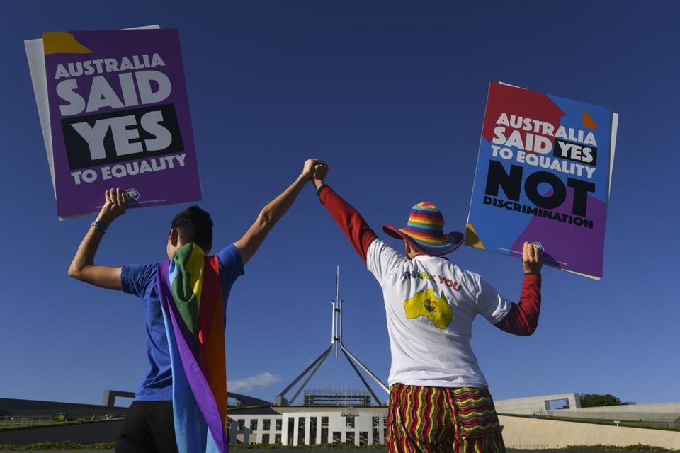 Same-sex marriage campaigners pose for pictures during an equality rally outside Parliament House in Canberra, Australian Capital Territory, Australia, on Thursday.