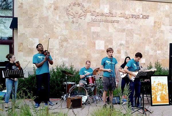 The Brookline Buds performing in August. The band includes the author's son Nat Batchelder (at microphone), Sri Sundar (violin), Theo Chartier (drums), Stefano Micali (guitar), Miyabe Shields (behind Stefano), and Elaine Shields (on left).