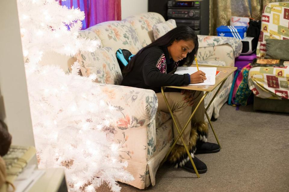 Ashantie Lopez did homework in the living room of her aunt's house in Springfield.