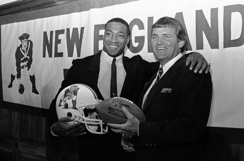 Former Patriots head coach Ron Meyer (right) with wide receiver Irving Fryar in 1984, before Meyer's final season with the Patriots. Meyer, 76, died Tuesday.