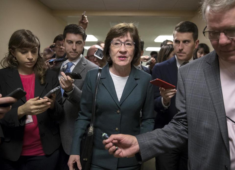 Sen. Susan Collins, R-Maine, and other senators rush to the chamber to vote on amendments as the Republican leadership works to craft their sweeping tax bill in Washington.