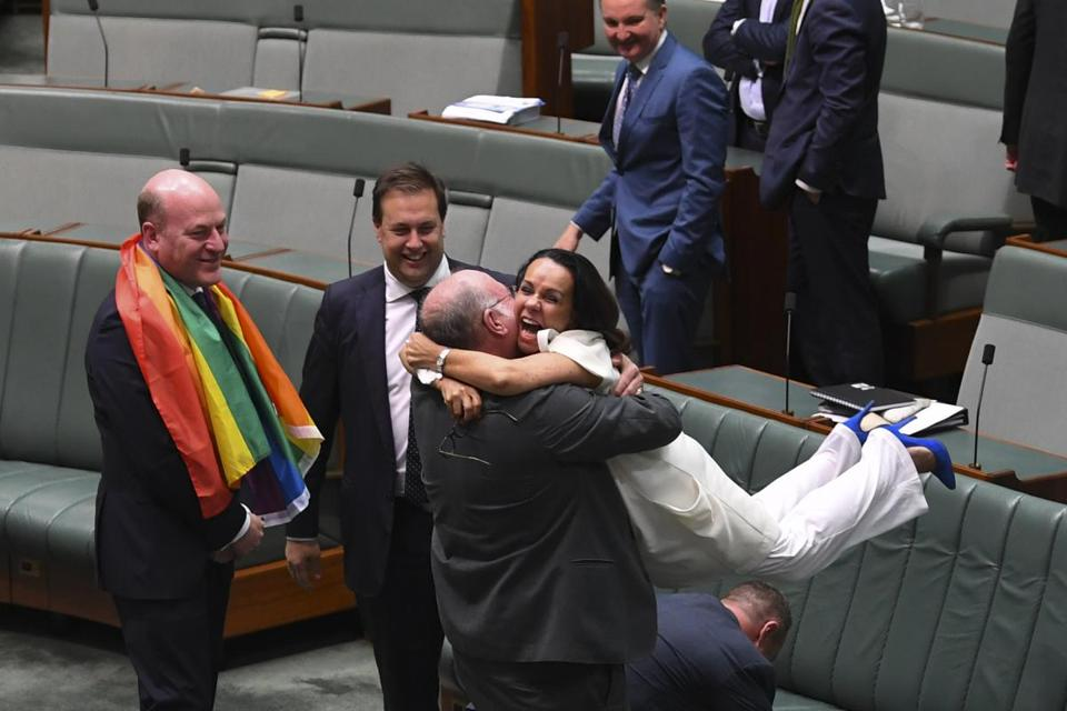 Lawmakers in Australia's House of Representatives celebrated the bill's passage Thursday.