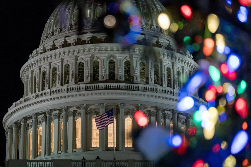 The 2017 Capitol Christmas Tree is lit on the West Lawn of the U.S. Capitol, Wednesday, Dec. 6, 2017, in Washington. The Capitol Christmas Tree has been a tradition since 1964, and this year's tree was chosen from Kootenai National Forest in Montana. (AP Photo/Andrew Harnik)