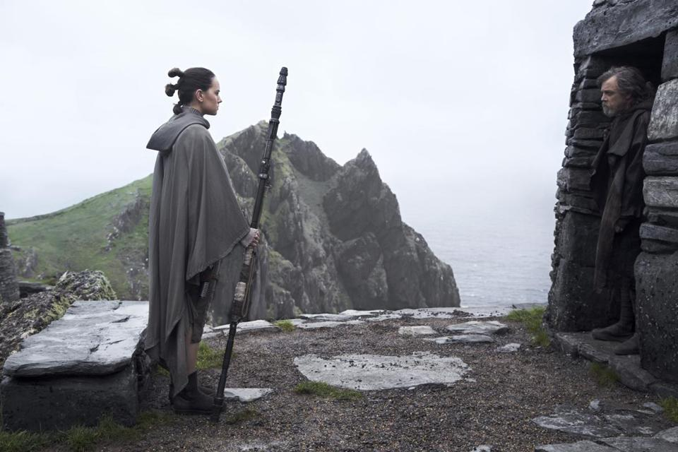 L to R: Rey (Daisy Ridley) and Luke Skywalker (Mark Hamill) in the 2017 film STAR WARS: THE LAST JEDI, directed by Rian Johnson. Photo: Jonathan Olley.©2017 Lucasfilm Ltd. All Rights Reserved.