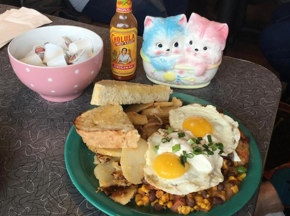 "17nodine - A pink kitten, hot sauce and a plate of the ""Costa Rican"" egg dish at the Friendly Toast. (Stephanie Schorow)"