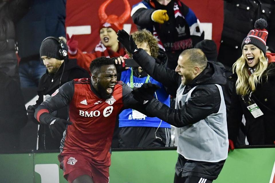 Toronto FC forward Jozy Altidore, left, celebrates his goal against the Seattle Sounders during second-half MLS Cup final soccer action in Toronto, Saturday, Dec. 9, 2017. (Frank Gunn/The Canadian Press via AP)