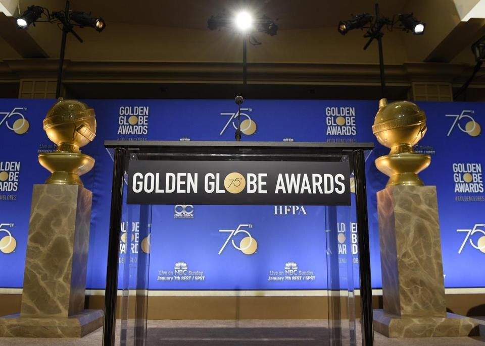 Two Golden Globes statues flank the podium prior to the nominations for 75th annual Golden Globe Awards at the Beverly Hilton hotel on Monday, Dec. 11, 2017, in Beverly Hills, Calif. The 75th annual Golden Globe Awards will be held on Sunday, Jan. 7, 2018. (Photo by Chris Pizzello/Invision/AP)