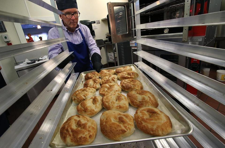George Blanchette, owner of Jetties Bagels, with freshly made plain bagels. The former engineer opened the bagel shop in early July. Mark Lorenz for the Boston Globe.