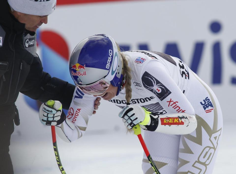 United States' Lindsey Vonn grimaces in pain after getting to the finish area after completing an alpine ski, women's World Cup super-G, in St. Moritz, Switzerland, Saturday, Dec. 9, 2017. (AP Photo/Giovanni Auletta)