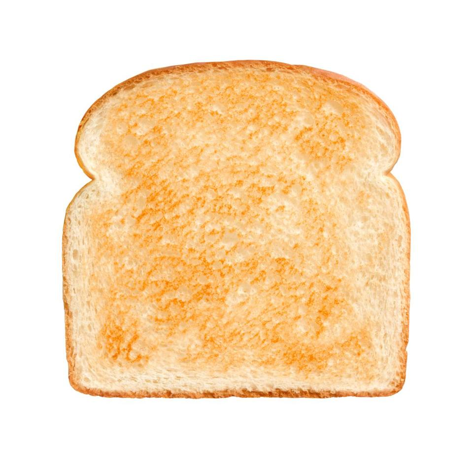 Single Slice of lightly toasted white bread isolated on a white background.