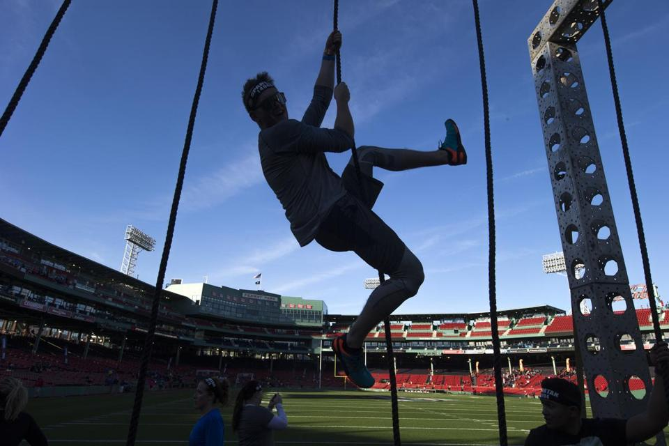 "Nov.4, 2017-Boston, Ma- Stan Grossfeld/Globe Staff-Photo Opportunity Spartan Transforms Fenway Park into an Obstacle Racing Battleground for 14,000 Competitors – November 4 & 5 Athletes of All Ages and Skill Levels to Compete in Three-Mile ""Stadium Sprint"" Race Course with 20 Obstacles; Participants Include Adaptive Athletes, Military Veterans and Kids WHO: More than 14,000 competitors of all ages and skill levels, including kids 4 years old and up. Notable participants include: • Pro obstacle course (OCR) racers Kate Cramer and Robert Killian • Adaptive Athletes/Military Veterans from the Oscar Mike Foundation • More than 500 kids from local schools and community centers WHAT: Spartan turns Fenway Park into a challenging obstacle race course as part of the Boston-based endurance brand's 2017 ""Stadium Series."" The Reebok Spartan Race event will bring a three-mile ""Sprint"" course with more than 20 obstacles to the confines of the storied ballpark, providing athletes with unique access while testing their strength and agility. Competitors will climb steep stairs, race down narrow concourses with sharp turns and conquer walls, rope climbs, monkey bars, burpees in the locker rooms and more."