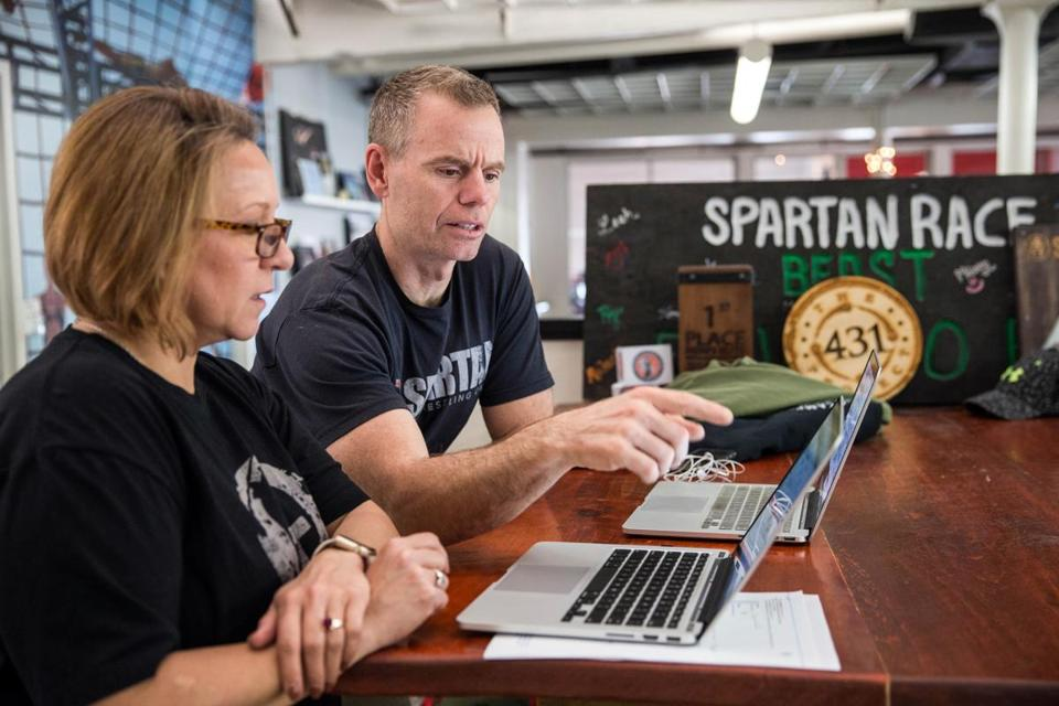 06/04/2017 BOSTON, MA Chief of Staff Hattie Douglas (cq) (left) and Spartan race founder Joe De Sena (cq) work together at their headquarters in Boston. (Aram Boghosian for STAT)