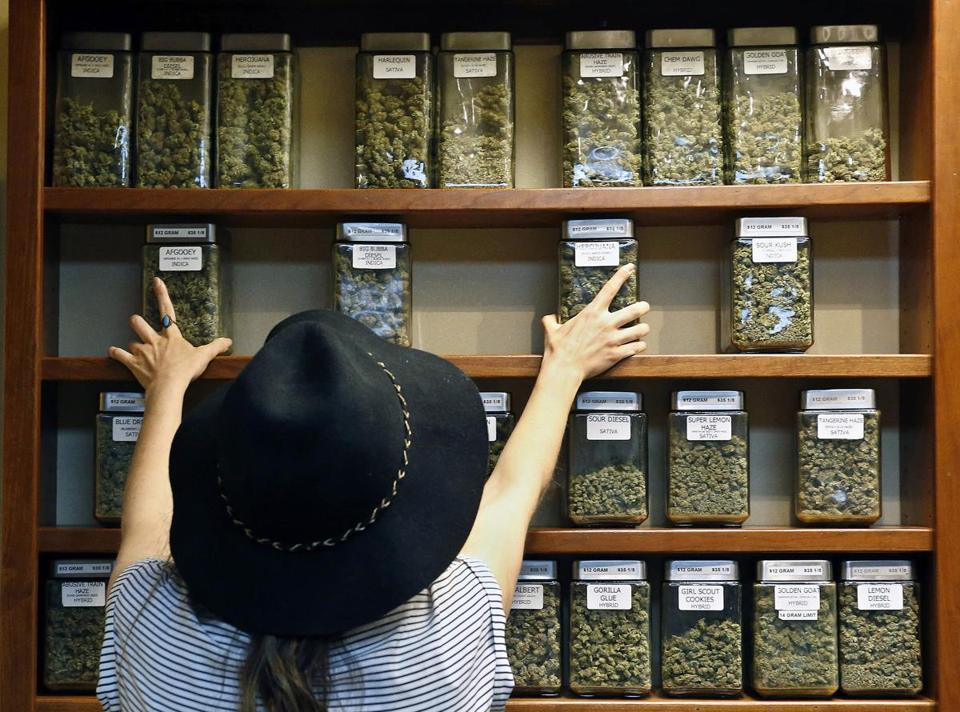 Assistant manager Jaclyn Stafford arranged display containers of marijuana at The Station, a retail and medical cannabis dispensary, in Boulder, Colo., on Aug. 11, 2016.
