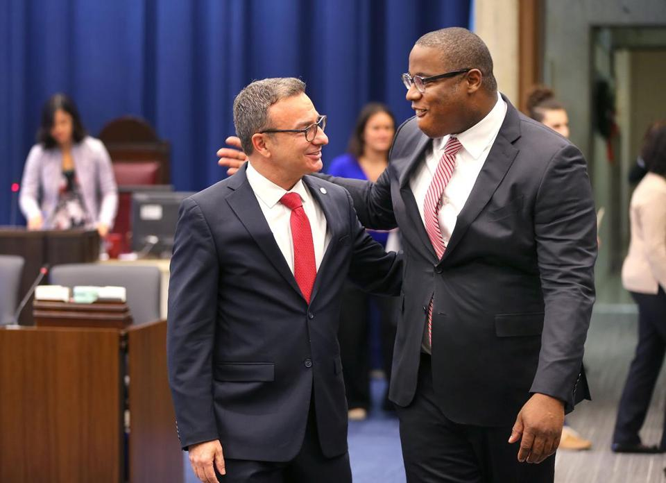 Tito Jackson (right) put his arm around Sal LaMattina as they walked to their seats in the City Council chamber Wednesday.