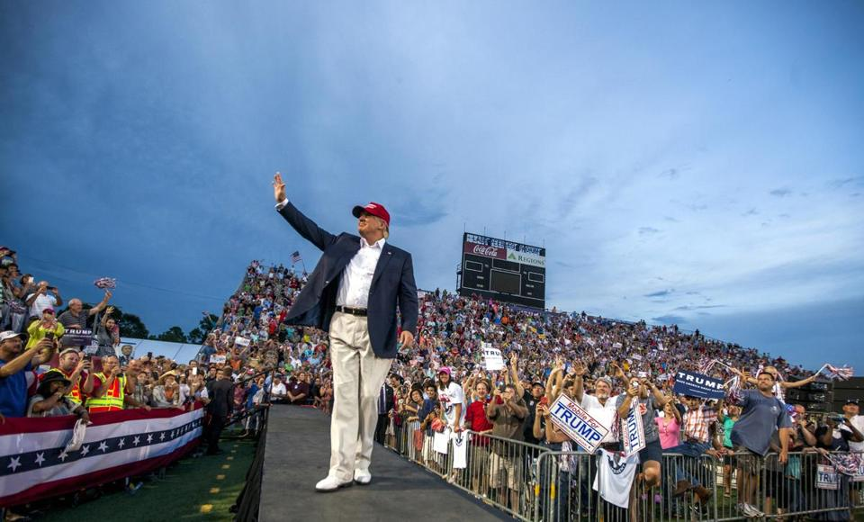 MOBILE, AL- AUGUST 21: U.S. Republican presidential candidate Donald Trump takes the stage at Ladd-Peebles Stadium on August 21, 2015 in Mobile, Alabama. The Donald Trump campaign moved tonight's rally to a larger stadium to accommodate demand. (Photo by Mark Wallheiser/Getty Images)