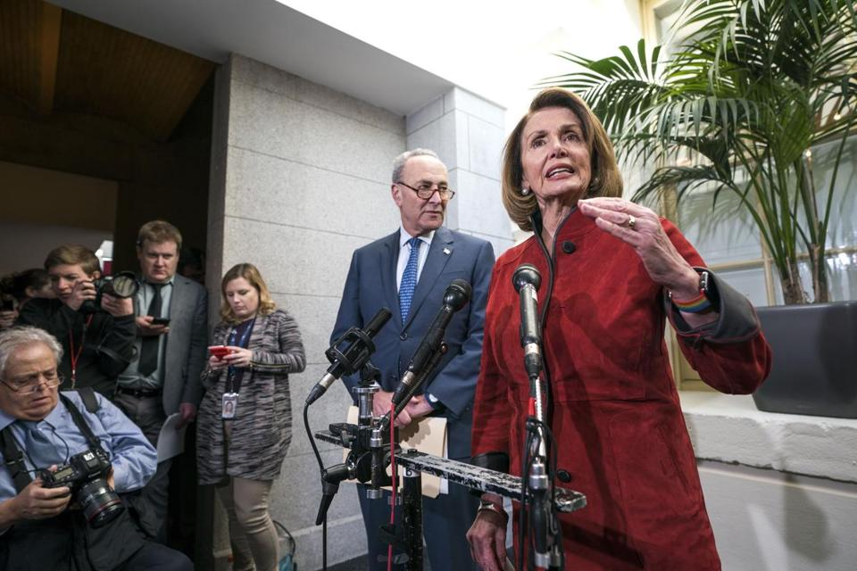 Democratic House Minority Leader Nancy Pelosi (right) spoke about the Republican tax bill while Democratic Senate Minority Leader Chuck Schumer (center) looked on in the US Capitol.