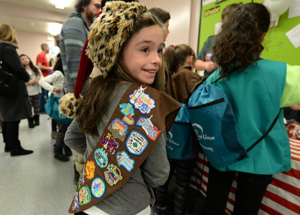 Quincy 12/13/2017: Badges adorn Mackenzie ILacqua , 8, Brownie uniform at the Holiday Craft Fair at the Wollaston Congregational Church in Quincy. Photo by Debee Tlumacki for the Boston Globe (south)