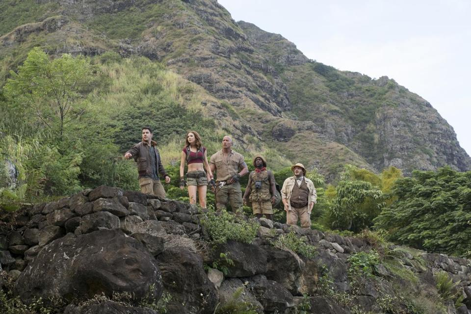 "Dwayne Johnson (center) with Nick Jonas, Karen Gillan, Kevin Hart, and Jack Black in ""Jumanji: Welcome to the Jungle."""