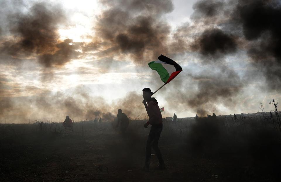 Mandatory Credit: Photo by MOHAMMED SABER/EPA-EFE/REX/Shutterstock (9294450v) Palestinian protesters during clashes near the border with Israel, against US President decision to recognize Jerusalem as the capital of Israel, in the east of Gaza City, 15 December 2017. Two Palestinians were killed during the clashes in the east of Gaza Strip. US president Donald J. Trump on 06 December announced he is recognizing Jerusalem as the Israel capital and will relocate the US embassy from Tel Aviv to Jerusalem. Clashes in East Gaza, --- - 15 Dec 2017