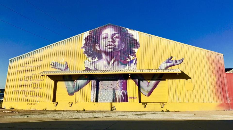 A mural by New Orleans street artist Brandan Odums on the outside of Studio Be
