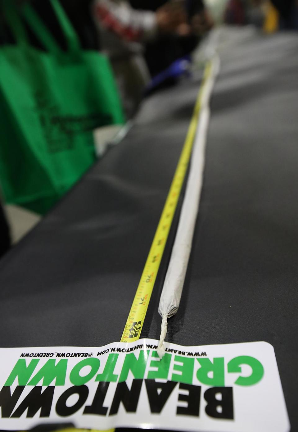 Worcester MA 12/16/17 Its 4:20pm, and the organizers rolled a 100-foot-long joint during the Harvest Cup a marijuana expo and contest to see who can grow the best pot at the DCU Center. The 106 foot joint took 2 pounds of marijuana to construct. It was delivered in 5 foot sections. (Matthew J. Lee/Globe staff) topic reporter: