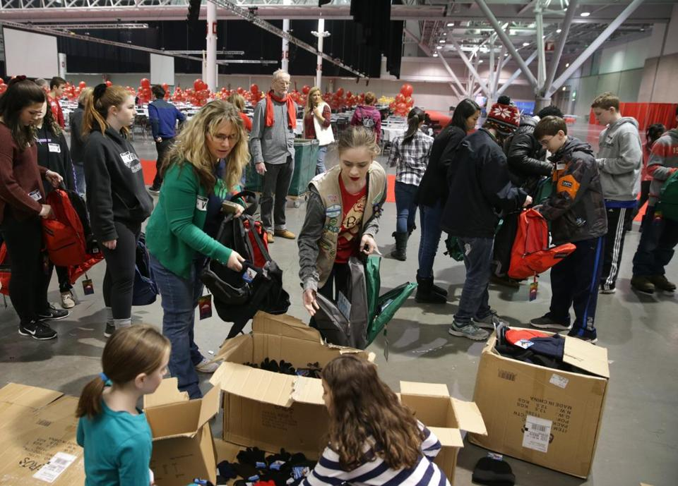 12/16/2017 Boston Ma- Medford Girl Scout Troop Leader Monique O'Connell () left and her daughter Marianne O'Connell () right volunteering for a charity event at the Boston Convention Center. Jonathan Wiggs\Globe Staff Reporter:Topic.