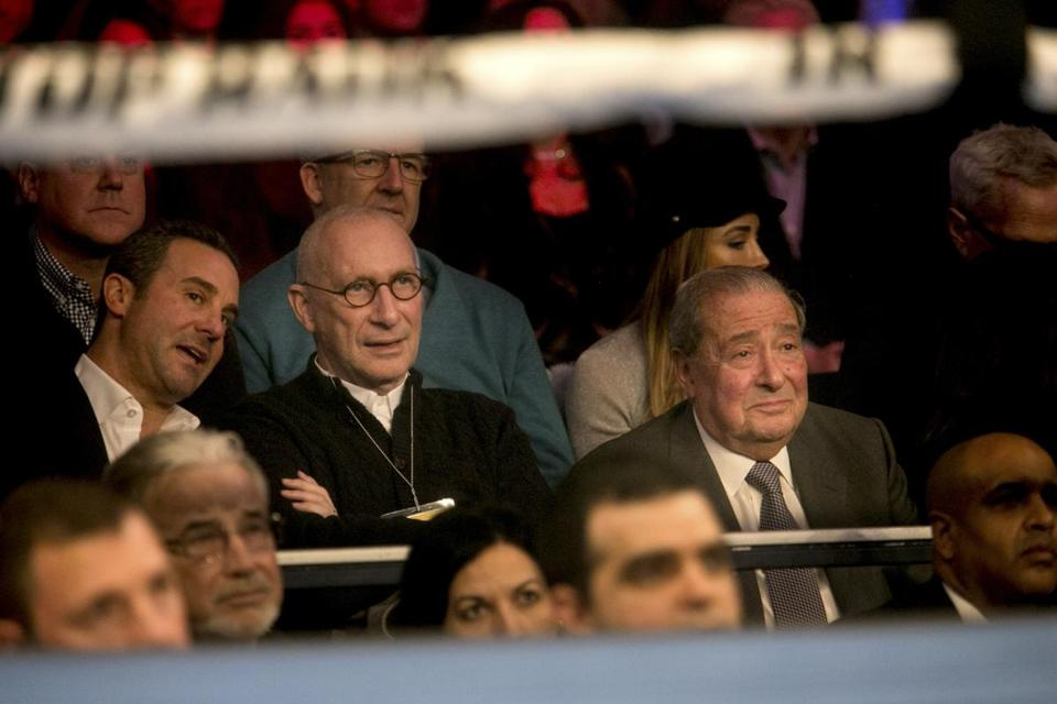 ESPN President John Skipper, in glasses, sat between Todd duBoef (left) and Bob Arum (right) of Top Rank as they watch the fight between Guillermo Rigondeaux and Vasyl Lomachenko at the Theater at Madison Square Garden in New York.