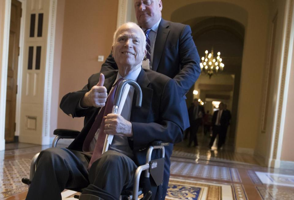 FILE - In this Dec. 1, 2017 file photo, Sen. John McCain, R-Ariz., leaves a closed-door session where Republican senators met on the GOP effort to overhaul the tax code, on Capitol Hill in Washington. President Donald Trump says McCain is returning home to Arizona after being hospitalized over the side effects from his brain cancer treatment. The 81-year-old McCain has been hospitalized at Walter Reed Medical Center in Maryland. (AP Photo/J. Scott Applewhite, File)