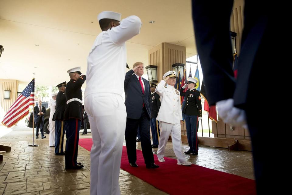 President Donald Trump and U.S. Pacific Command Commander Adm. Harry Harris, second from right, salute during a welcome ceremony at U.S. Pacific Command (PACOM), Friday, Nov. 3, 2017, in Aiea, Hawaii. Trump begins a 5 country trip through Asia traveling to Japan, South Korea, China, Vietnam and the Philippians. (AP Photo/Andrew Harnik)