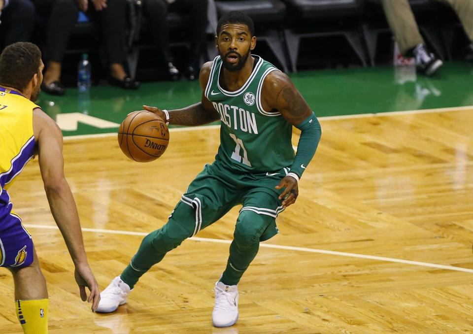Boston Celtics' Kyrie Irving during the first quarter of an NBA basketball game against the Los Angeles Lakers in Boston Wednesday, Nov. 8, 2017. (AP Photo/Winslow Townson)