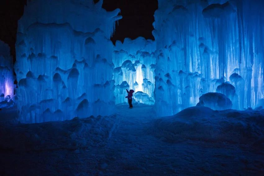 Madison Frigon, 3, of Groton, Vermont, visited the lit-up world of the ice castle in Lincoln, New Hampshire, on Jan. 13, 2015.