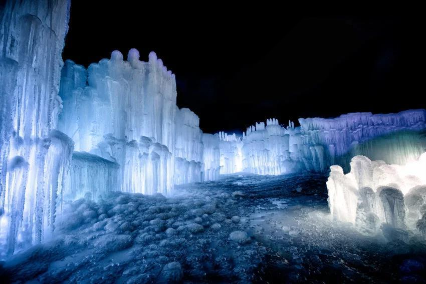 The glowing Ice Castles in Lincoln, New Hampshire.