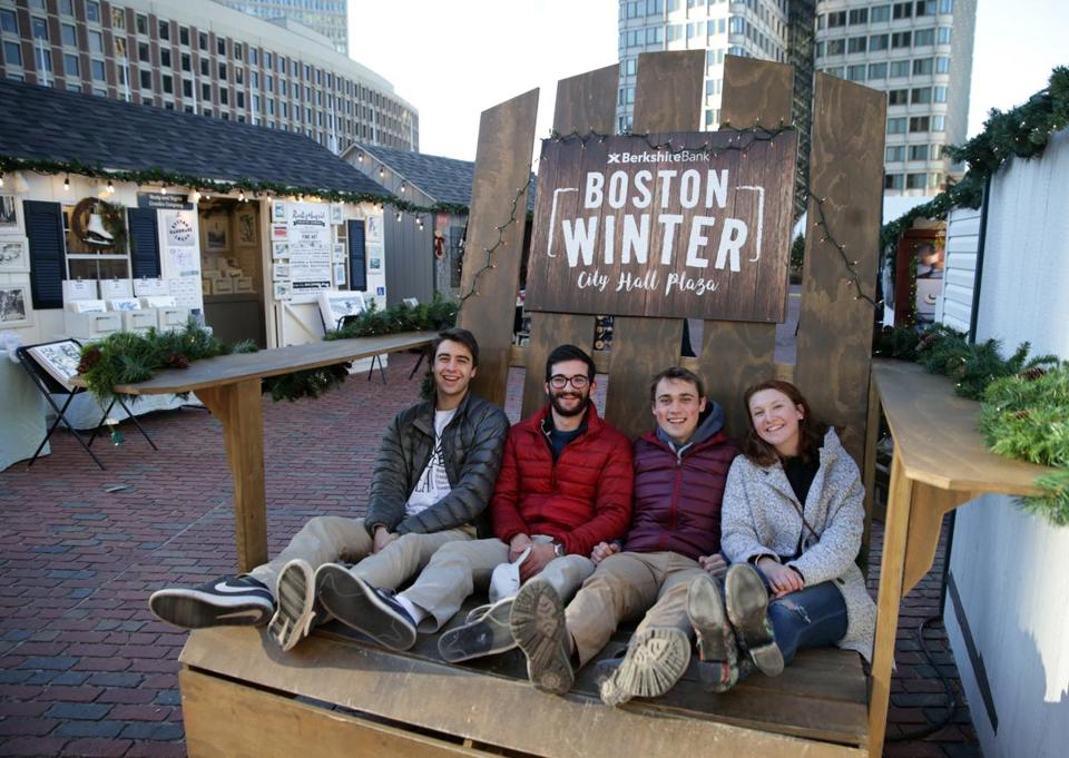 12/22/2017 Boston Ma- Boston Winter on City Hall Plaza visitors left to right are Emerson Wells (cq) Miles Tepper (cq) Quentin Boose (cq) and Stephanie Acquario (cq). Jonathan Wiggs\Globe Staff Reporter:Topic. pper