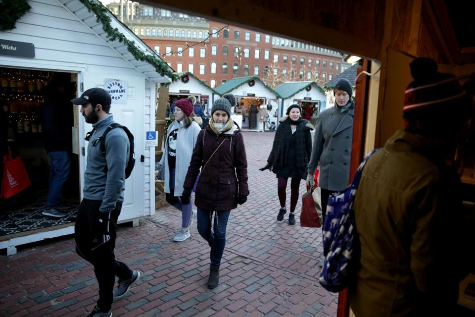 Visitors to Boston Winter ducked inside one of the outdoor market's vendor huts. More than 80 vendors have set up shop there, twice as many as last year.