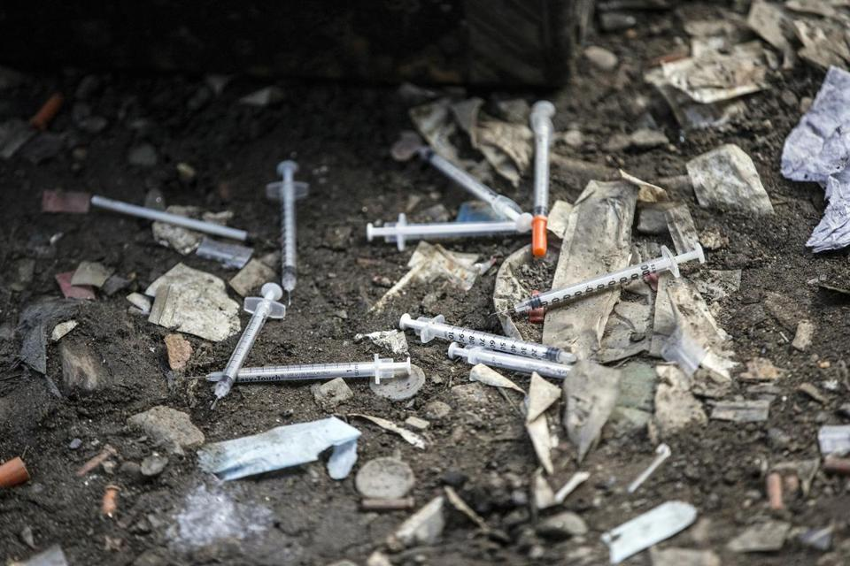 Used needles littered the ground at an open air drug market along train tracks in Philadelphia's Kensington section.