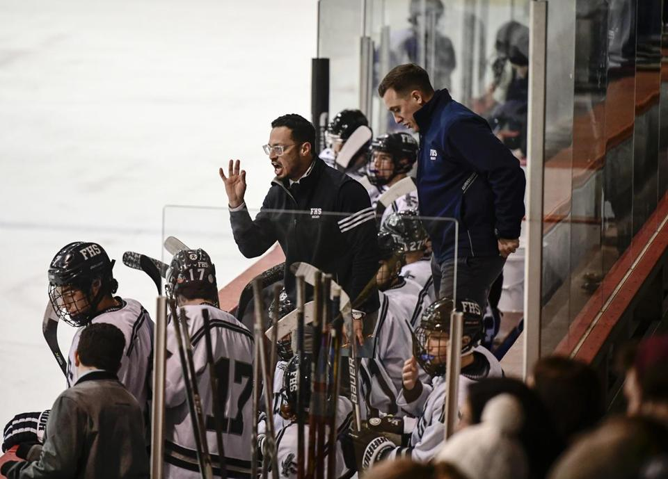 Framingham, MA - 12/20/2017 - Braintree vs. Framingham boys' hockey in a matchup of Bay State Conference contenders. Will Ortiz (Framingham) directing traffic from the bench.(John Cetrino for The Boston Globe) SPORTS (David Souza)